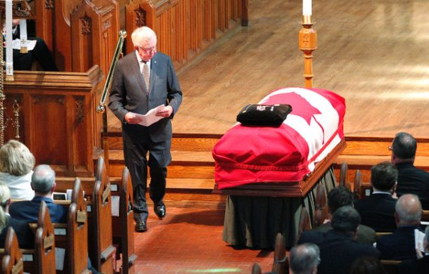 Former Prime Minister Joe Clark walks by Flora MacDonald's casket. Source: Ottawa Sun/Matt Day