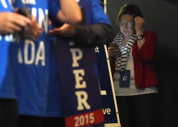 Conservative Party campaign manager Jenni Byrne, right, is seen at a Harper campaign stop in Toronto, Ontario on Tuesday, August 18, 2015. THE CANADIAN PRESS/Sean Kilpatrick