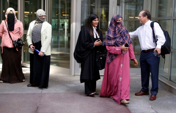 Zunera Ishaq, second from right, leaves the Federal Court of Appeal after her case was heard on whether she can wear a niqab while taking her citizenship oath, in Ottawa on Tuesday, September 15, 2015. THE CANADIAN PRESS/ Patrick Doyle