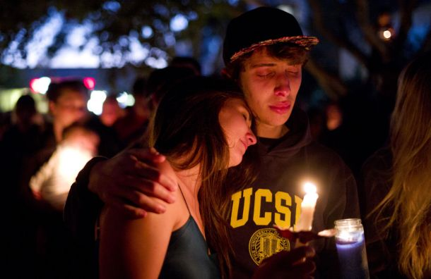 Two students comfort each other during a candlelight vigil held to honor the victims of the murders at the University of California, Santa Barbara, in May 2014. Credit: Jae C. Hong/Associated Press